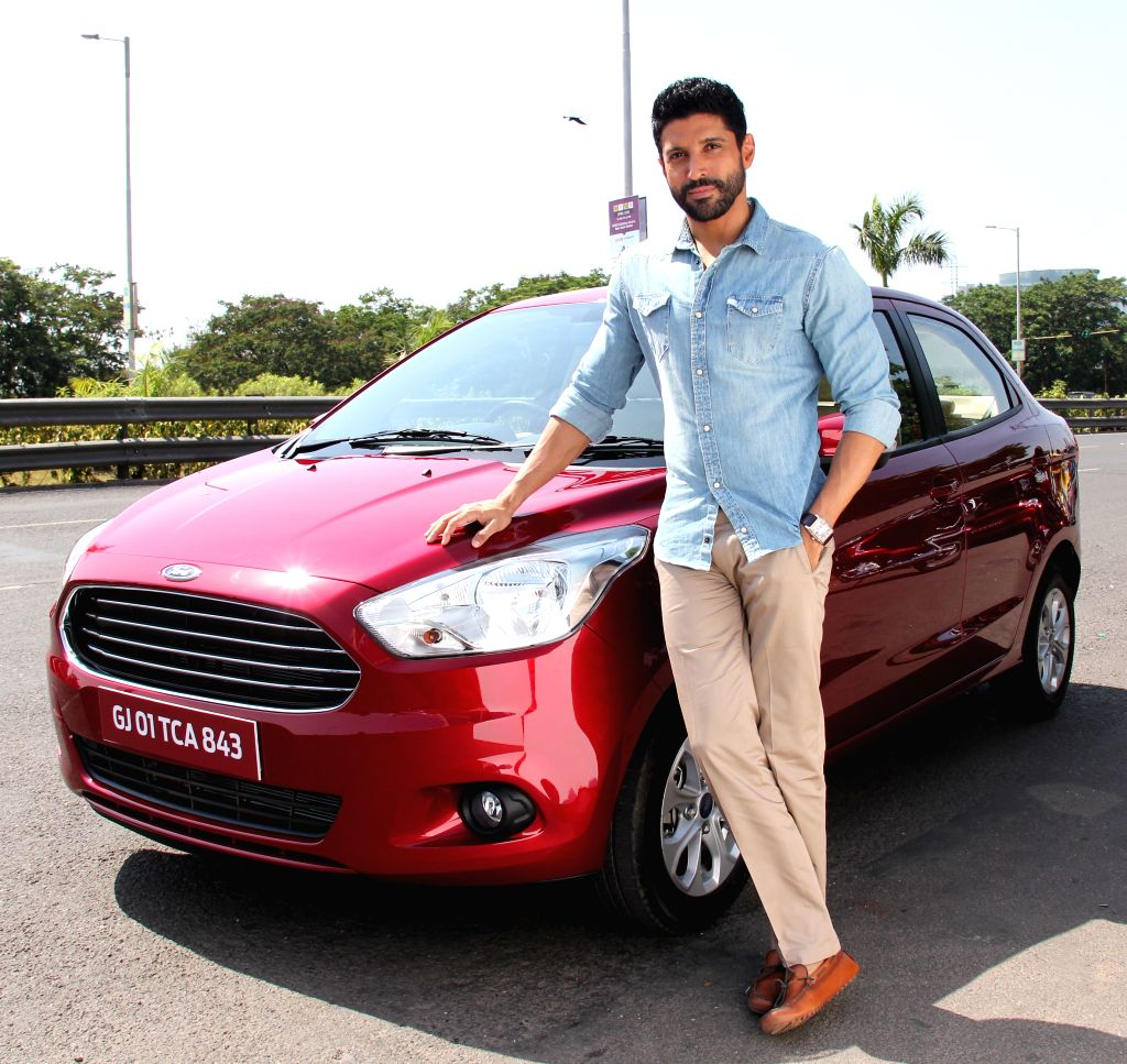 Filmmaker Farhan Akhtar poses with Ford Figo Aspire.