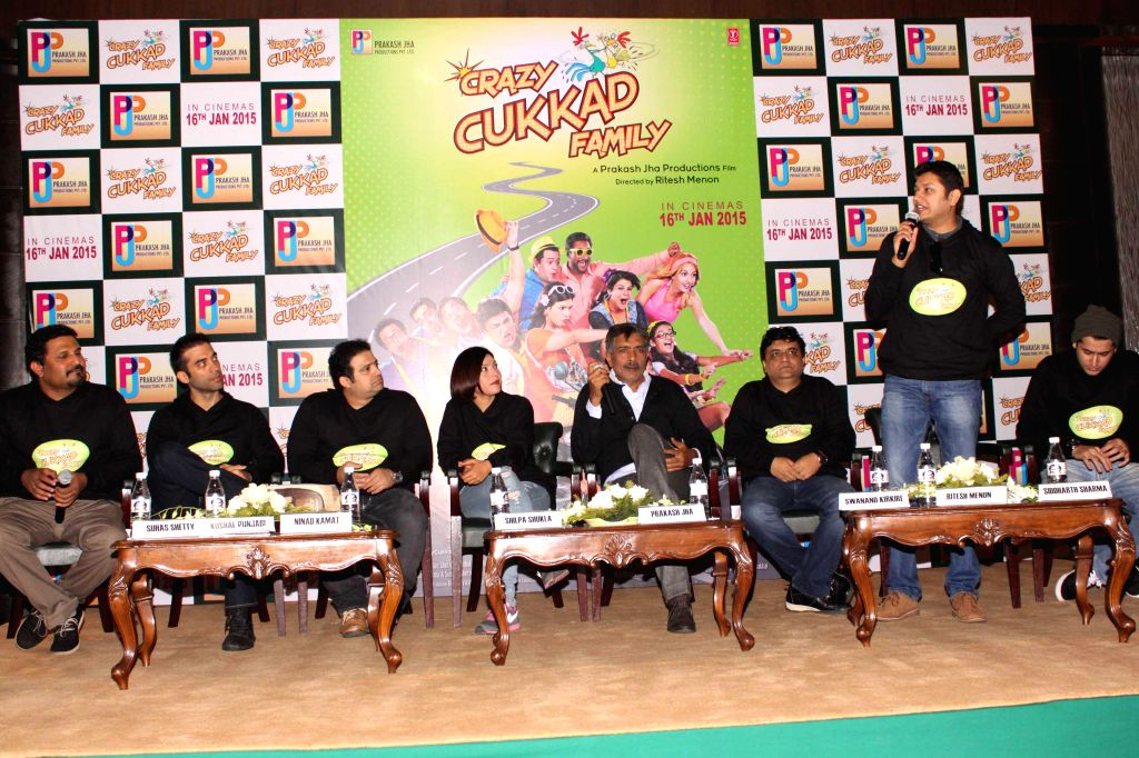 Filmmaker Prakash Jha with the starcast of his upcoming film `Crazy Cukkad Family` during a press conference in New Delhi on Jan. 6, 2015. - Prakash Jha