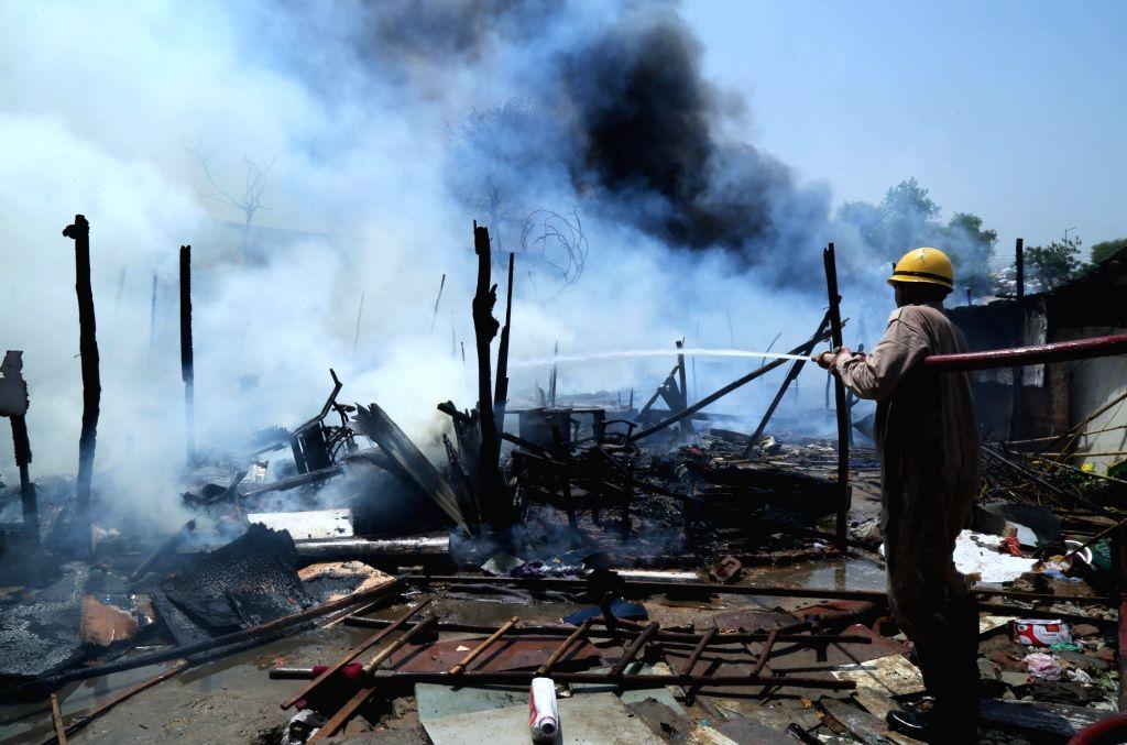New Delhi: Fire breaks out at a slum in Laxmi Nagar area of New Delhi, on April 27, 2019. (Photo: IANS)