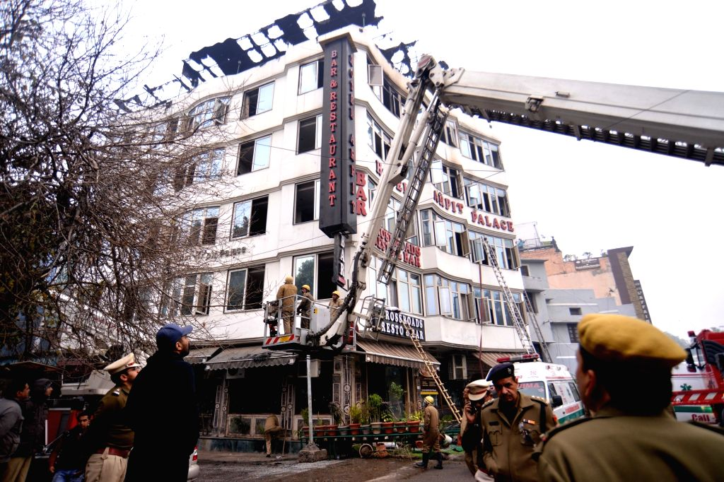 New Delhi: Fire service officials try to douse fire at Arpit Palace Hotel in Karol Bagh, New Delhi on Feb. 12, 2019. A child and 16 others, including a woman was killed in a major fire  that engulfed several storeys of this central Delhi hotel. (Phot