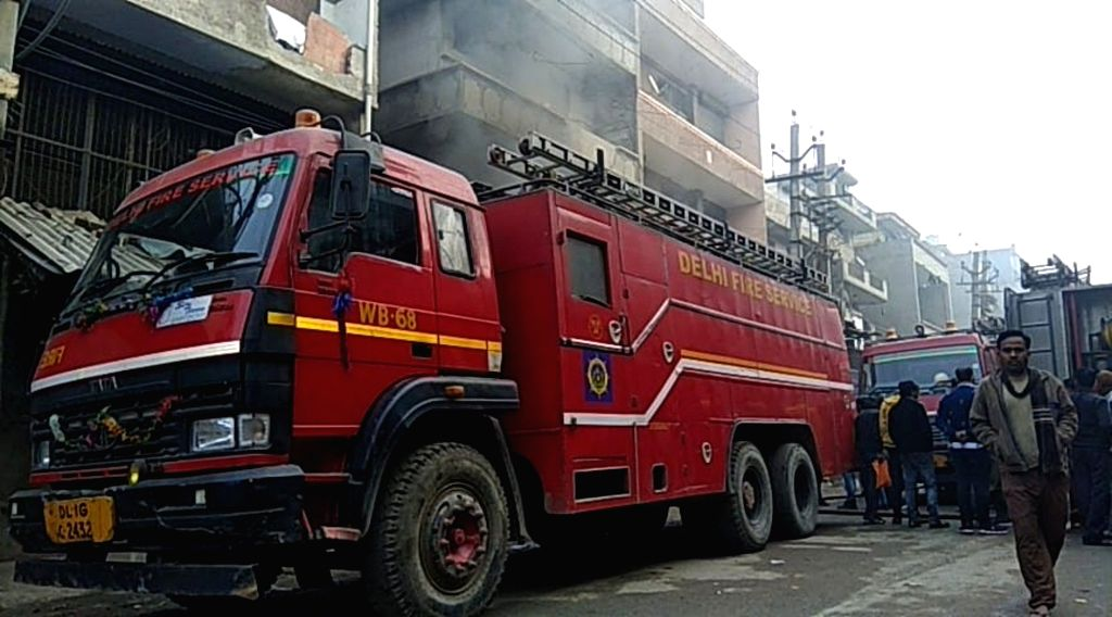 New Delhi: Fire tenders at the factory in Delhi's Narela industrial area where a fire broke out in New Delhi, on Feb 19, 2019. The cause of the blaze is under probe. (Photo: IANS)