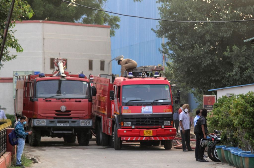 New Delhi :  Fire Tenders  try to control on fire at Airport Authority Of India Safdarjung in New Delhi on Monday, 14 June 2021.