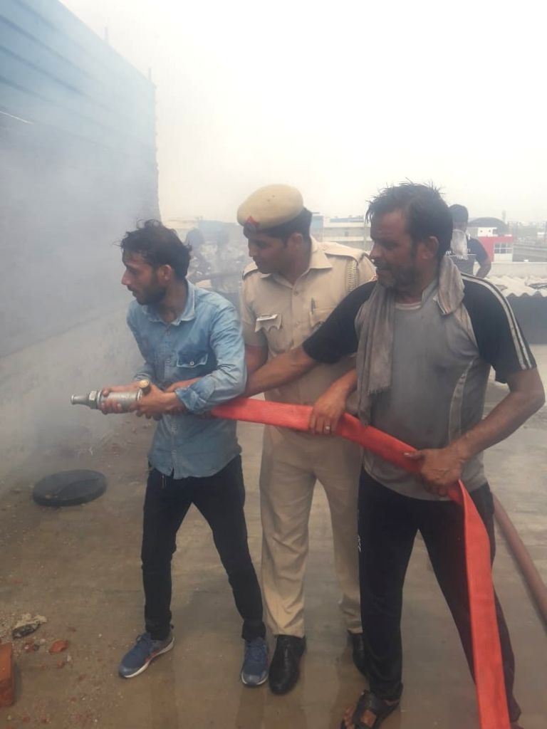 New Delhi: Firefighting operations underway at the rubber factory where a major fire broke out leaving three people with severe burn injuries, in Jhilmil Industrial Area near Delhi's Dilshad Garden, on July 13, 2019. (Photo: IANS)