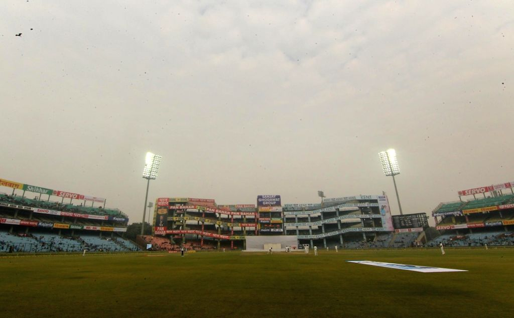 New Delhi: Floodlights are on as the fog envelops Ferozshah Kotla ground during Day 4 of the third test match between India and Sri Lanka at Feroz Shah Kotla Stadium in New Delhi on Dec 5, 2017. (Photo: Surjeet Yadav/IANS) - Surjeet Yadav