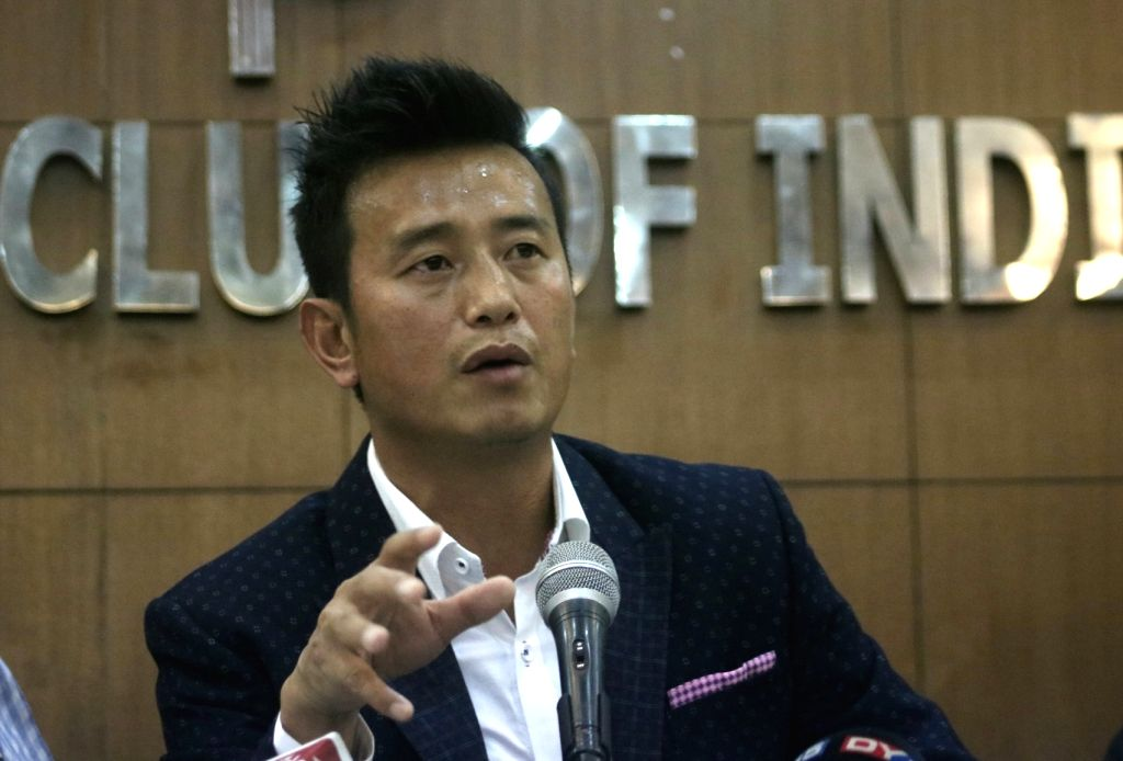 """New Delhi: Footballer-turned-politician Bhaichung Bhutia addresses a press conference to announce his own political party """"Hamro Sikkim"""" at the Press Club in New Delhi on April 26, 2018. (Photo: IANS)"""