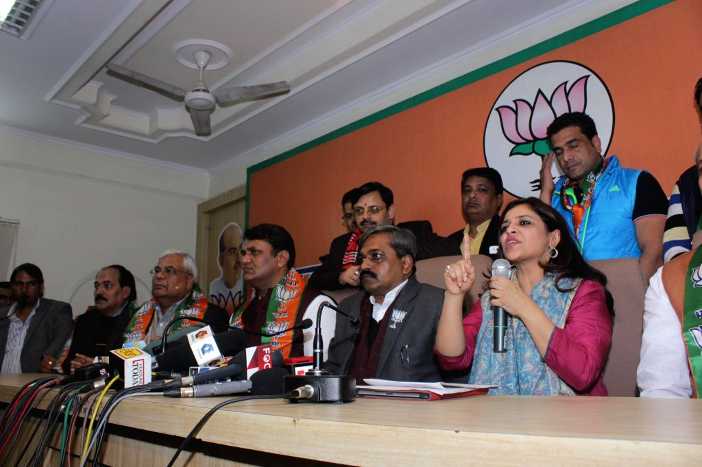 Former Aam Aadmi Party MLA Vinod Kumar Binny joins BJP in presence of Delhi BJP chief Satish Upadhyay in New Delhi, on Jan 18, 2015. Also seen BJP leader Shazia Ilmi. - Satish Upadhyay