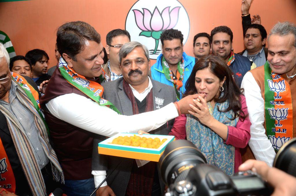 Former Aam Aadmi Party MLA Vinod Kumar Binny joins BJP in presence of Delhi BJP chief Satish Upadhyay, party leader Shazia Ilmi and others in New Delhi, on Jan 18, 2015. - Satish Upadhyay