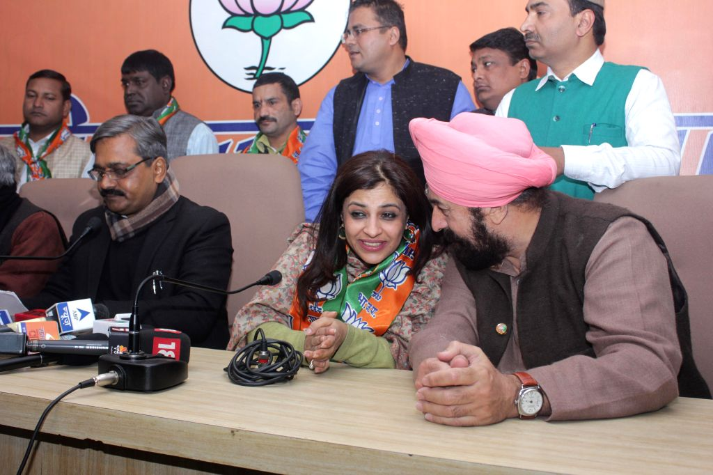 Former AAP leader, social activist and journalist Shazia Ilmi joins BJP in presence of Delhi BJP chief Satish Upadhyay and others in New Delhi on Jan 16, 2015. - Satish Upadhyay