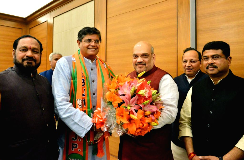 New Delhi: Former Biju Janata Dal (BJD) MP Baijayant Jay Panda with BJP leaders Amit Shah and Dharmendra Pradhan after joining BJP in New Delhi on March 4, 2019. (Photo: IANS) - Amit Shah
