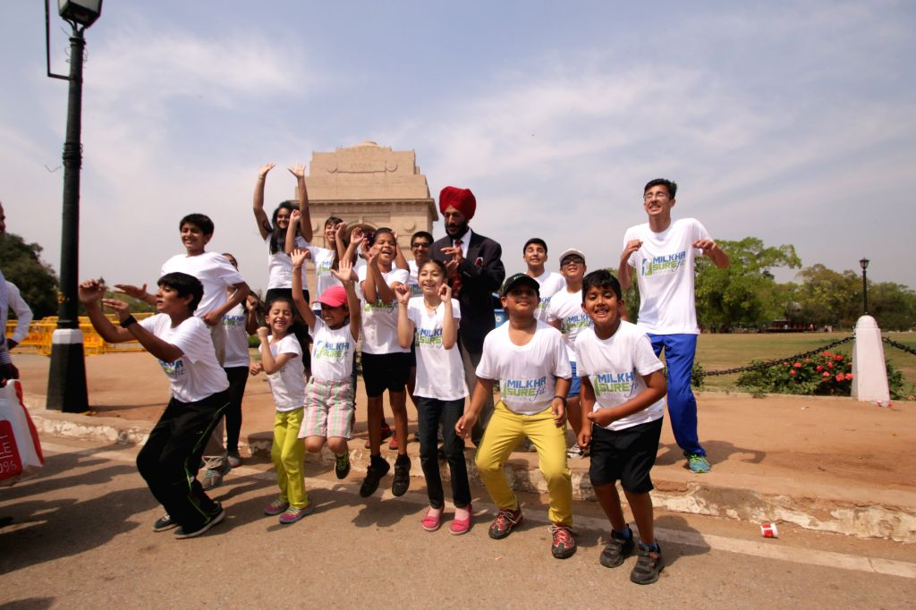 Former Indian track and field sprinter Milkha Singh with children during a programme at the India Gate in New Delhi on April 1, 2015.
