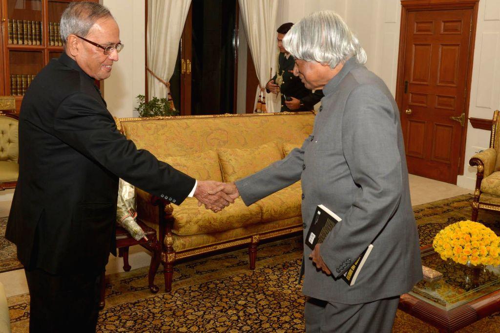 New Delhi:Former President of India Dr. A.P.J. Abdul Kalam calls on President Pranab Mukherjee at Rashtrapati Bhavan in New Delhi, on Dec 24, 2014. - Pranab Mukherjee