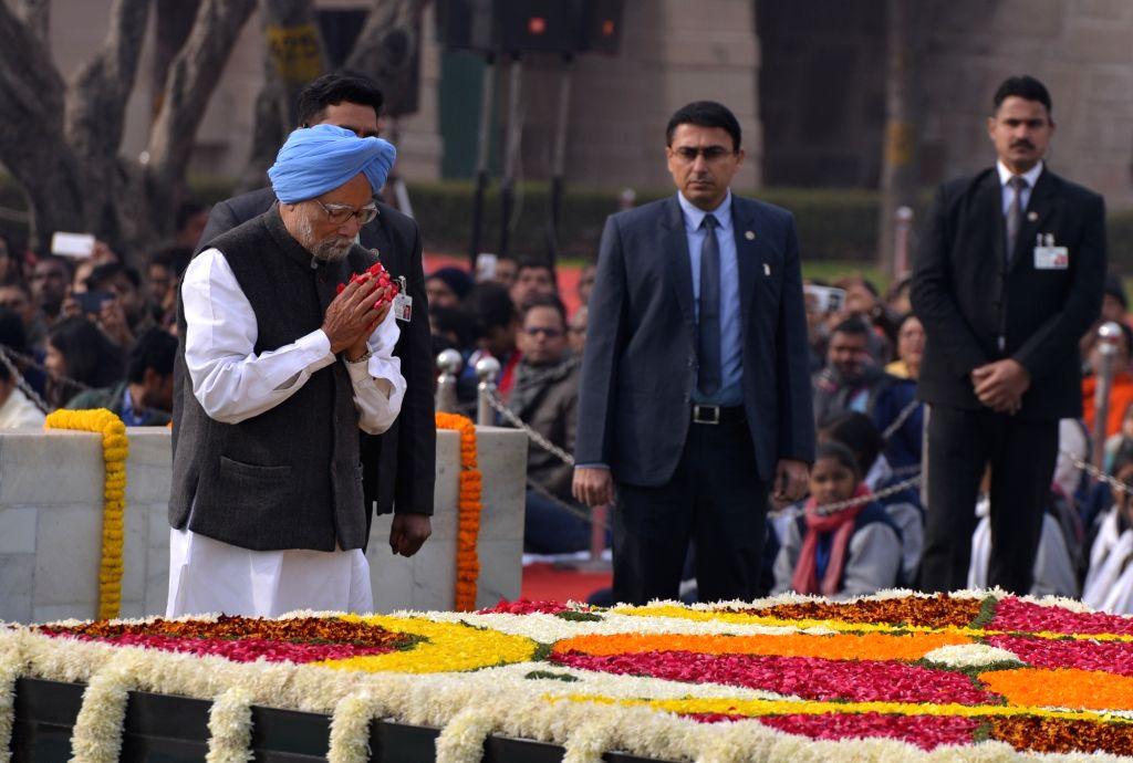 New Delhi: Former Prime Minister Manmohan Singh pays tribute to Mahatma Gandhi on his death anniversary at Raj Ghat in New Delhi onJan. 30, 2019. (Photo: IANS) - Manmohan Singh