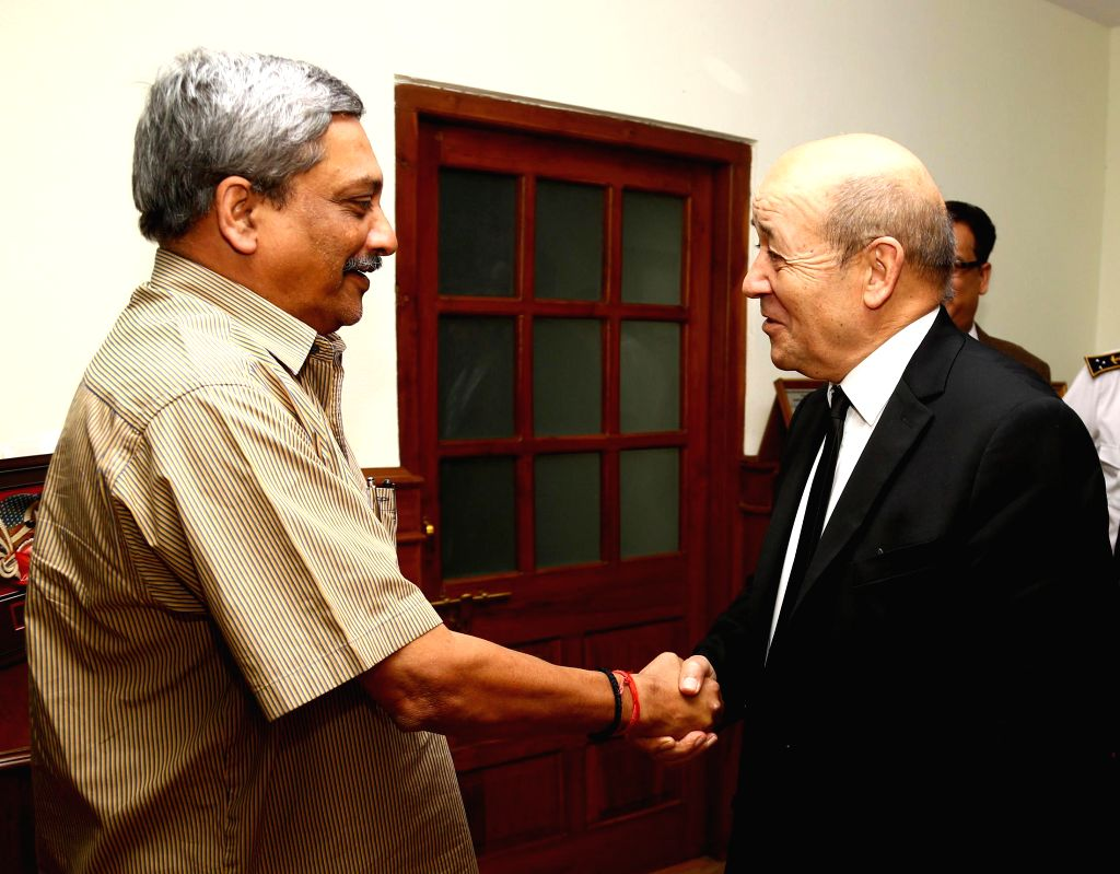 French Defence Minister Jean Yves Le Drian calls on the Union Minister for Defence Manohar Parrikar, in New Delhi on Feb 24, 2015. - Jean Yves L