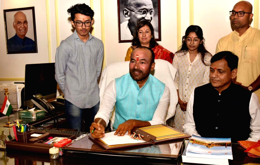 New Delhi : G. Kishan Reddy takes charge as the Minister of State for Home Affairs, in New Delhi on June 1, 2019. Also seen MoS Home Affairs Nityanand Rai. - G. Kishan Reddy and Affairs Nityanand Rai