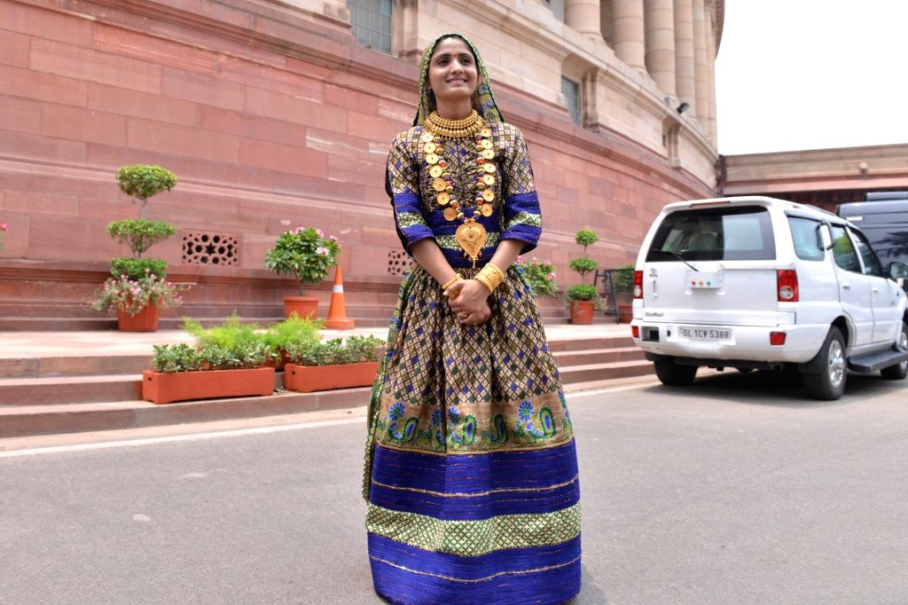 New Delhi: Gujarati folk singer Geeta Rabari after meeting Prime Minister Narendra Modi at Parliament, in New Delhi on July 8, 2019. (Photo: IANS) - Narendra Modi
