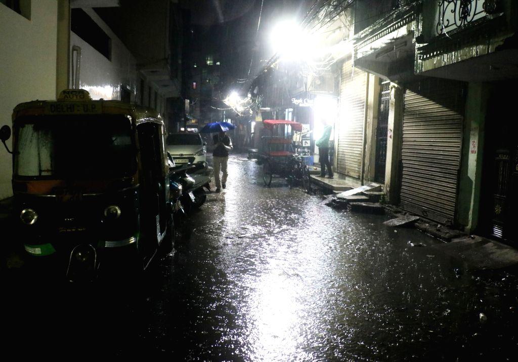 New Delhi: Heavy rain lashes Delhi on Dec. 12, 2019. (Photo: IANS)