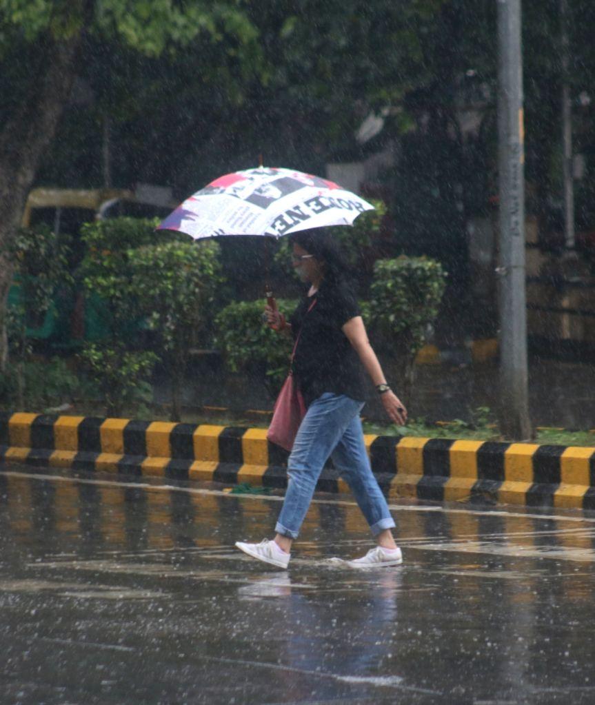New Delhi: Heavy rains lash New Delhi, on Aug 29, 2018. (Photo: IANS)