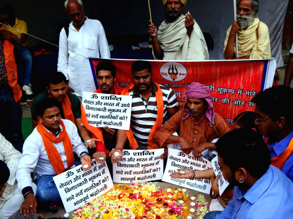 Hindu Sena activists pay tribute to the victims of Nepal earthquake at Jantar Mantar in New Delhi, on April 29, 2015.