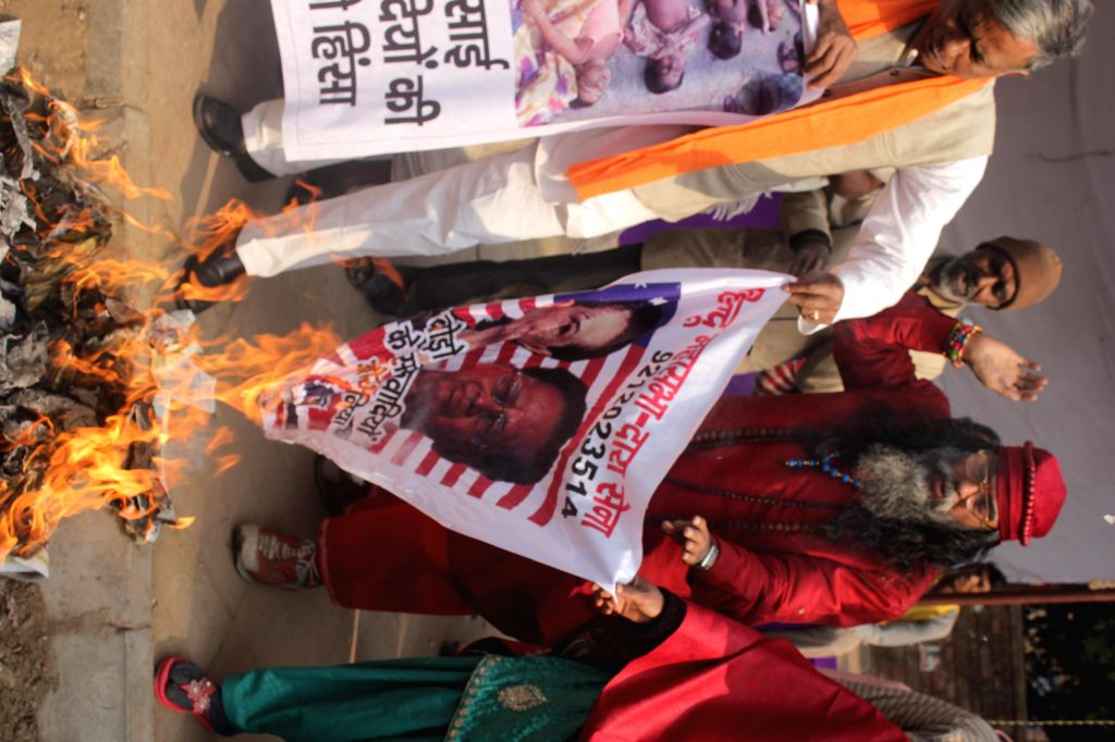 Hindu Sena activists stage a demonstration to protest against the recent Bodo militant attack in Assam that left 73 people dead, at Jantar Mantar in New Delhi on Dec 27, 2014.