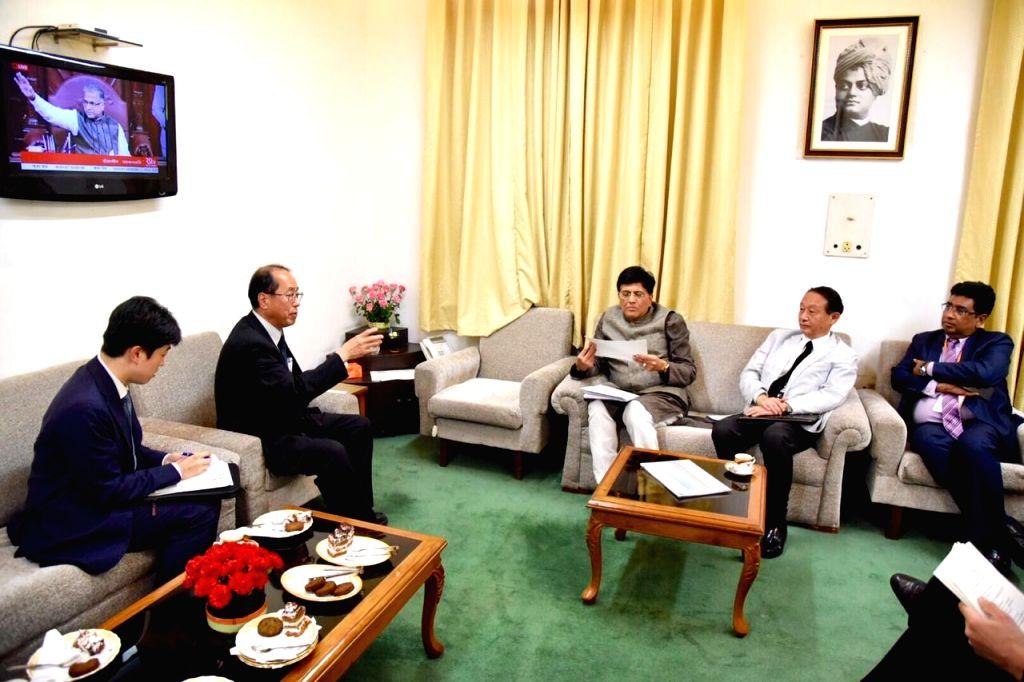 New Delhi: Hiroto Izumi, Special Advisor to Japan Prime Minister Shinzo Abe meets Union Minister for Railways Piyush Goyal to discuss the progress of the 508 km Mumbai-Ahmedabad High Speed Rail Project in New Delhi on July 25, 2019. (Photo: IANS) - Shinzo Abe