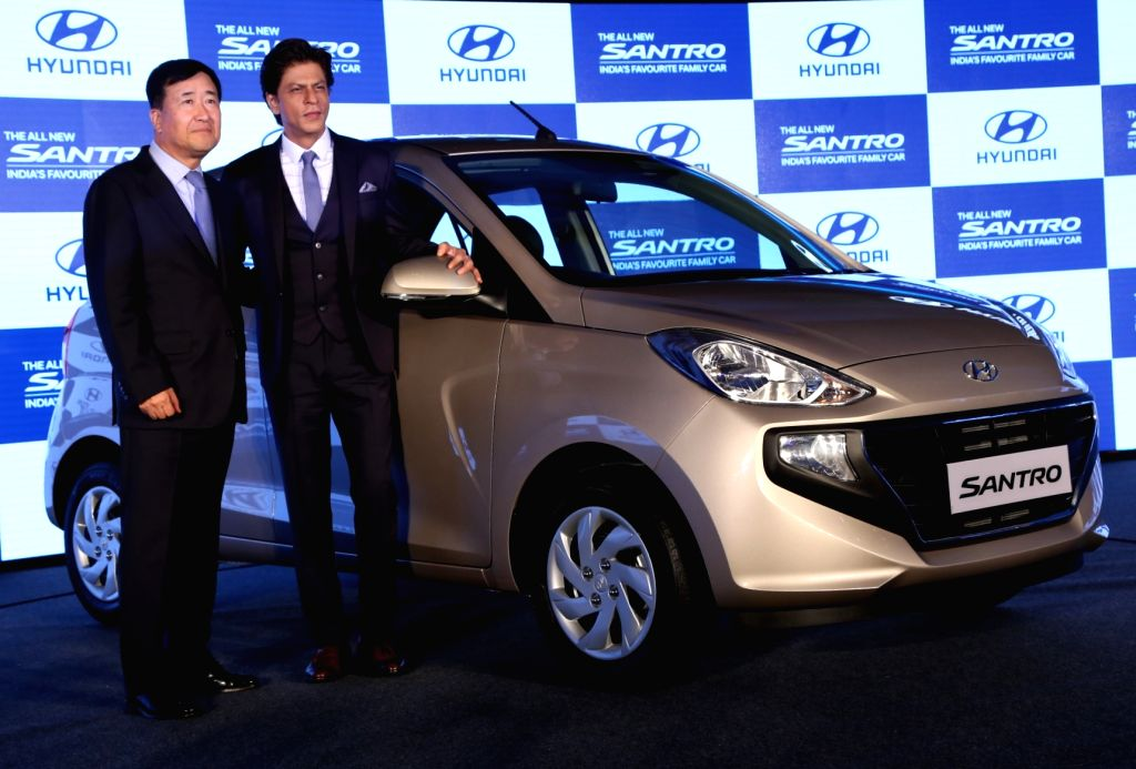 :New Delhi: Hyundai Motor India Ltd MD and CEO Y K Koo and actor Shah Rukh Khan pose with the newly launched 2018 Hyundai Santro in New Delhi, on Oct 23, 2018. .