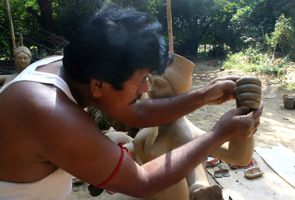 New Delhi: Idols of Goddess Durga being prepared at a workshop at CR Park ahead of Durga Puja celebrations, in New Delhi on Oct 7, 2020. (Photo: IANS)