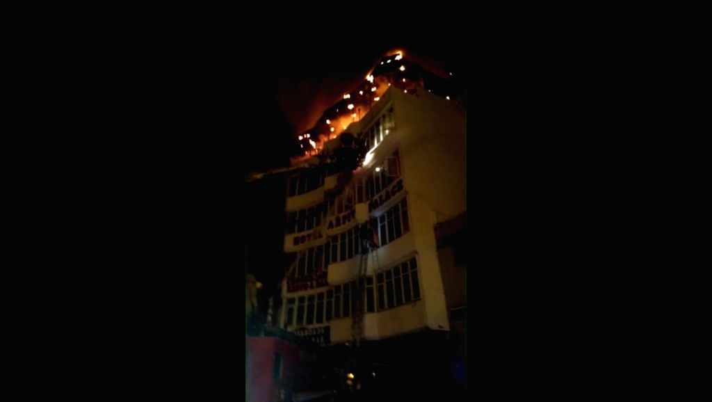 New Delhi: Imphal: A massive fire breaks out at Hotel Arpit Palace in Karol Bagh killing seventeen people, including a child and injuring three others in New Delhi on Feb 12, 2019. (Photo: IANS)