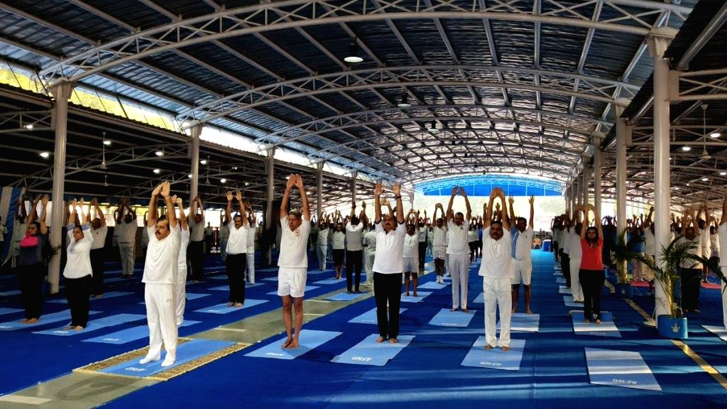 New Delhi: Indian Air Force personnel along with their families practice yoga asanas -postures- on International Yoga Day 2019 at AFS New Delhi on June 21, 2019. (Photo: IANS/IAF)