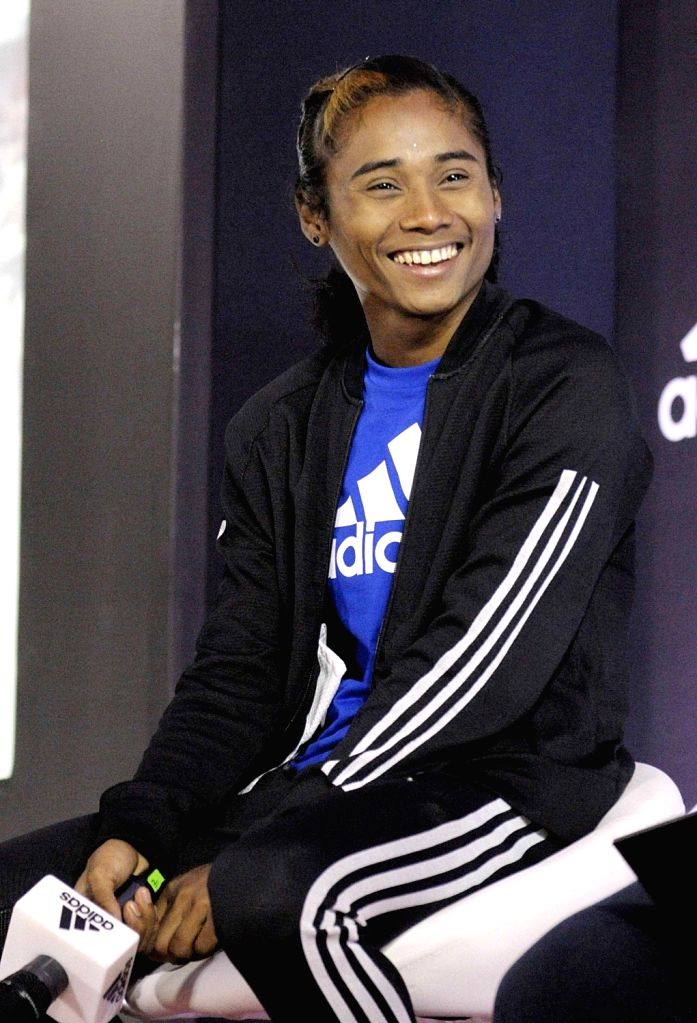 :New Delhi: Indian athlete Hima Das during a press conference where she signed an endorsement deal with Adidas, in New Delhi, on Sept 18, 2018. (Photo: IANS).