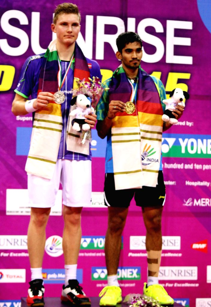 Indian badminton player Srikanth Kidambi with his Danish counterpart Viktor Axelsen after winning Indian Open Badminton Championship in New Delhi on March 29, 2015.