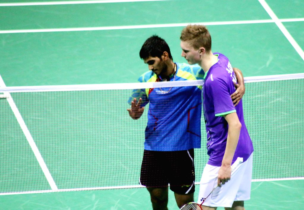 Indian badminton player Srikanth Kidambi and his Danish counterpart Viktor Axelsen during a match of Indian Open Badminton Championship in New Delhi on March 29, 2015.