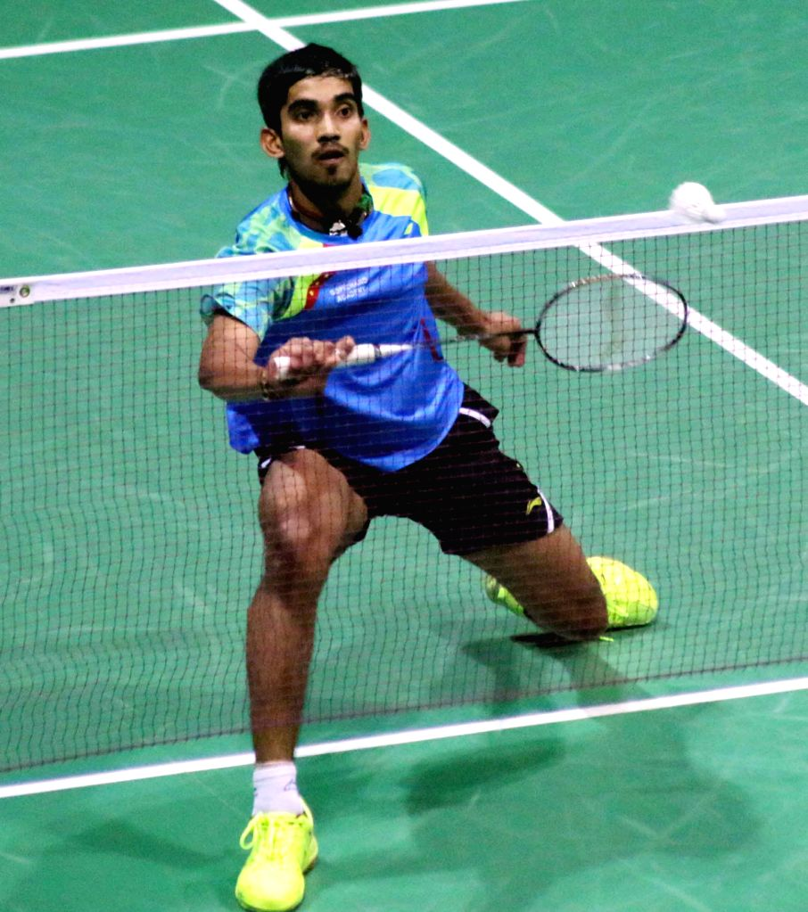 Indian badminton player Srikanth Kidambi returns a shot to his Danish counterpart Viktor Axelsen during a match of Indian Open Badminton Championship in New Delhi on March 29, 2015.