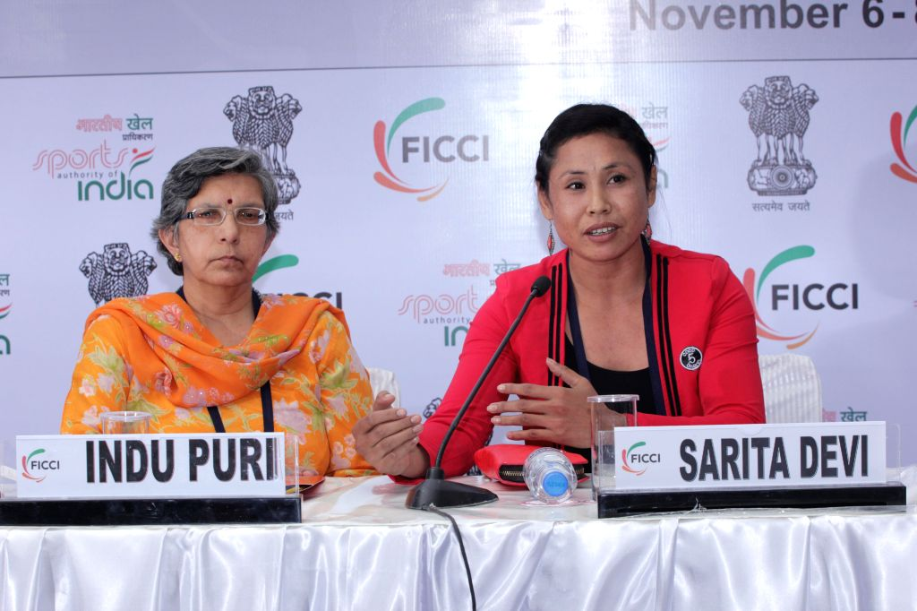 Indian boxer Laishram Sarita Devi, who won bronze medal in 2014 Asian Games during a programme organised by FICCI in New Delhi, on Nov 7, 2014.
