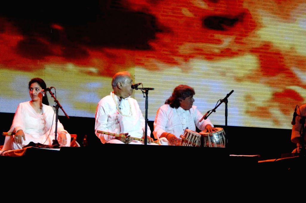 Indian classical flautist Pandit Hariprasad Chaurasia performs during Panchtatva -  a  Concert Tour in New Delhi on Jan 23, 2015.
