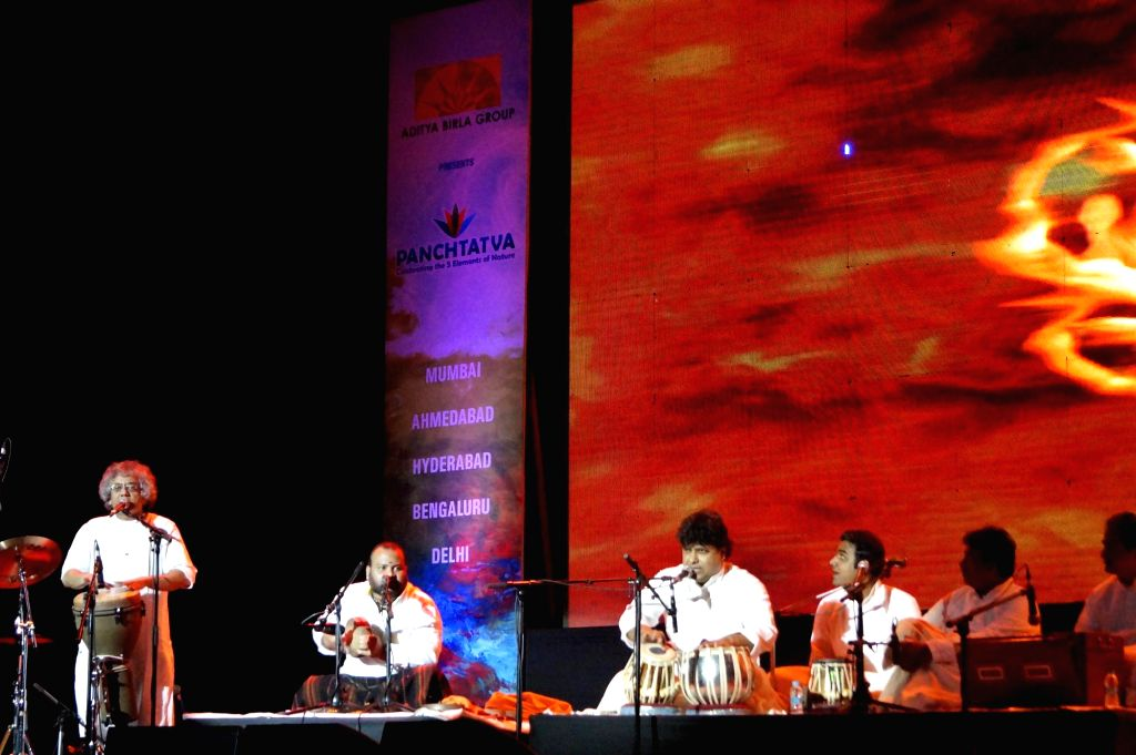 Indian classical musician Taufiq Qureshi performs during Panchtatva -  a  Concert Tour in New Delhi on Jan 23, 2015.