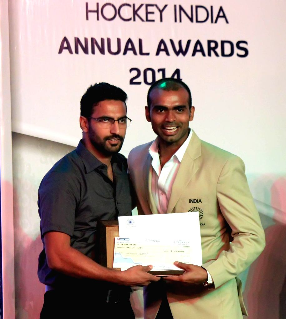 Indian hockey player P R Sreejesh honoured with a (Goalkeeper of the Year) at the inaugural of Hockey India Awards 2015 in New Delhi, on March 28, 2015.