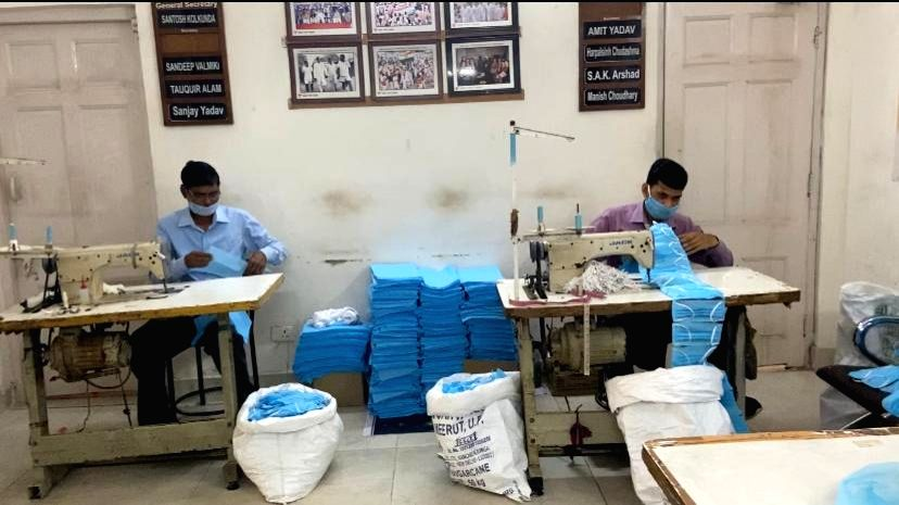 New Delhi: Indian Youth Congess (IYC) members busy making masks under the #MaskPehnoIndia initiative, wherein it aims to distribute masks to the underprivileged people of the country, who are not in a position to buy the masks themselves, in New Delh