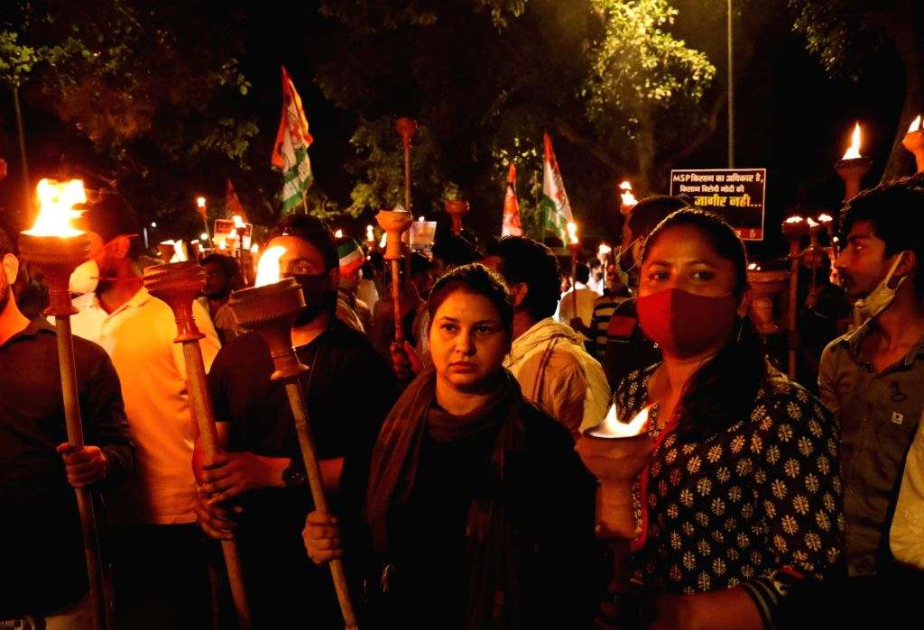 New Delhi: Indian Youth Congress (IYC) activists led by IYC President Srinivas BV take out a torch rally in support of the farmers and against the Central Government over the recently passed controversial Farm Bills 2020, in New Delhi on Sep 24, 2020