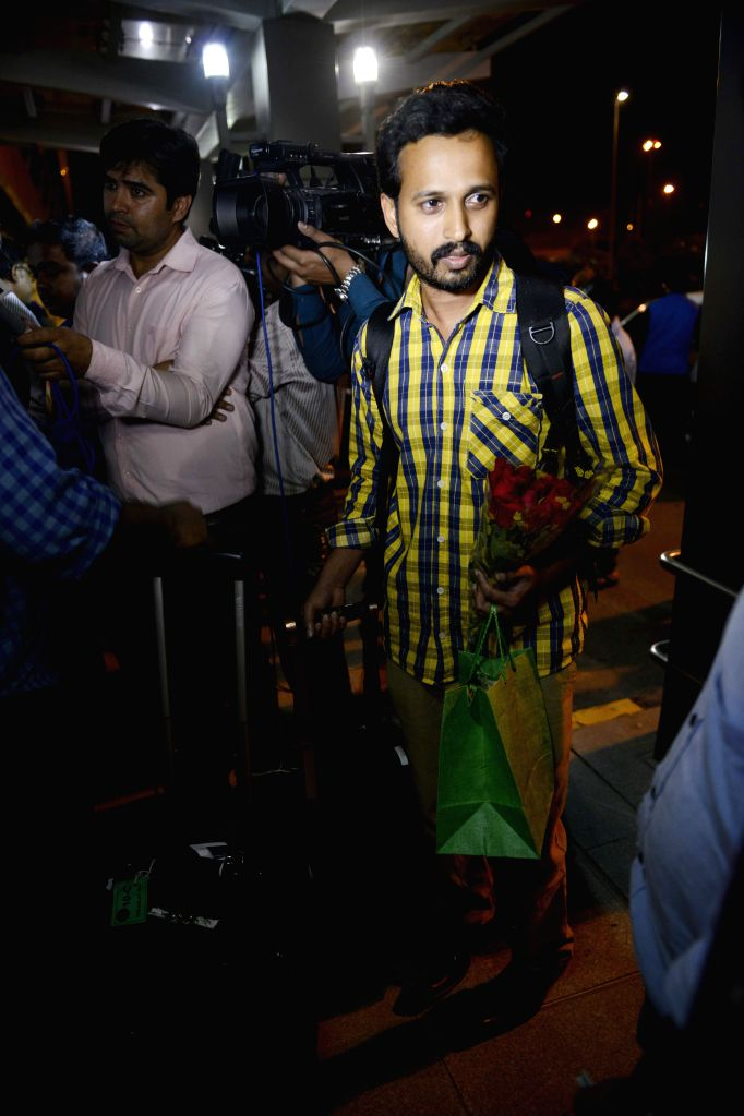 Indians evacuated by Pakistan Navy from violence-hit Yemen arrive at the IGI Airport, in New Delhi on April 8, 2015.