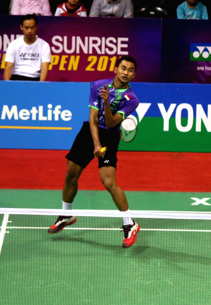 Indonesian badminton player Tommy Sugiarto returns a shot to Lin Dan of China during the men`s singles match of Yonex Sunrise Indian Open Badminton Championship in New Delhi on March 27, ...