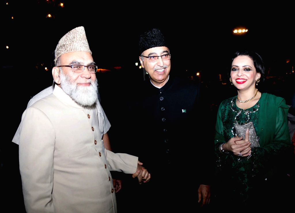 Jama Masjid Shahi Imam Syed Ahmed with the Pakistan High Commissioner to India Abdul Basit during a programme organised at the Pakistan High Commission on Pakistan National Day, in New ...
