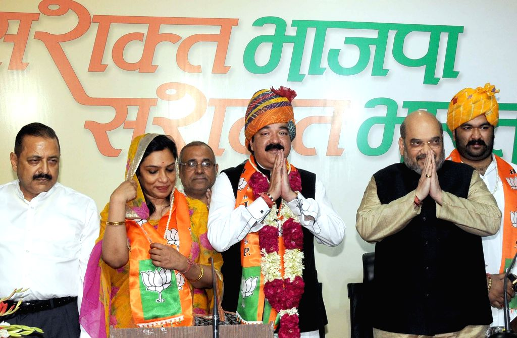 jammu and Kashmir's erstwhile royal family member and Congress leader Karan Singh's son Ajatshatru Singh joins BJP in presence of BJP leader Amit Shah  in New Delhi, on Nov 9, 2014.He was . - Karan Singh and Amit Shah