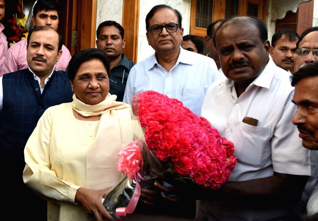 :New Delhi: Janata Dal-Secular (JD-S) leader and Karnataka Chief Minister-designate H.D. Kumaraswamy meets BSP chief Mayawati, in New Delhi on May 21, 2018. (Photo: IANS).