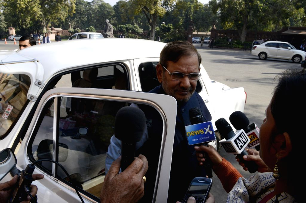 JD(U) chief Sharad Yadav talks to press at the Parliament premises in New Delhi on Dec 4, 2014. - Sharad Yadav