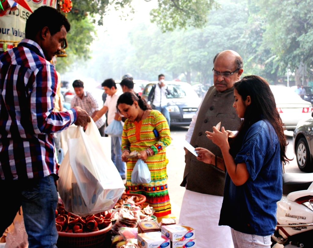 :New Delhi: JD(U) General Secretary KC Tyagi busy shopping ahead of Diwali at Mandi House Market in New Delhi, on Nov 10, 2015. .