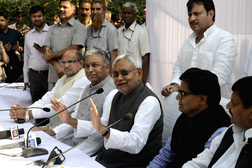 JD(U) leader and former Bihar chief minister Nitish Kumar addresses press at a luncheon meeting called by Samajwadi Party (SP) chief Mulayam Singh Yadav to announce united front - which ... - Nitish Kumar, Mulayam Singh Yadav and Gopal Yadav