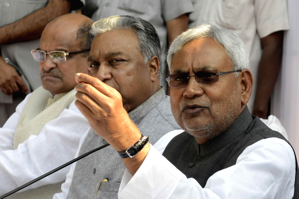 JD(U) leader and former Bihar chief minister Nitish Kumar addresses press at a luncheon meeting called by Samajwadi Party chief Mulayam Singh Yadav to announce united front - which ... - Nitish Kumar, Mulayam Singh Yadav, Lalu Prasad Yadav and Sharad Yadav