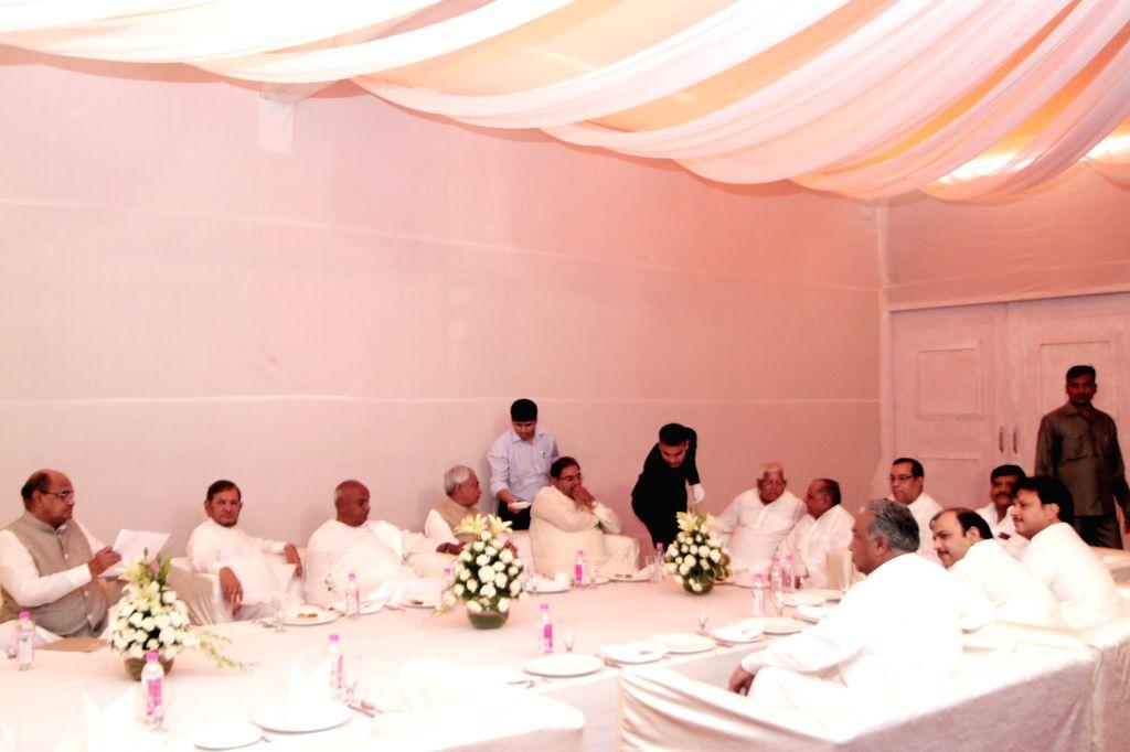 JD(U) leaders K C Tyagi, Sharad Yadav, Nitish Kumar, JD(S) leader H. D. Deve Gowda, RJD leader Lalu Yadav, SP chief Mulayam Singh and others during a party Janata Parivar meeting at SP ... - Sharad Yadav, Nitish Kumar, Lalu Yadav and Mulayam Singh
