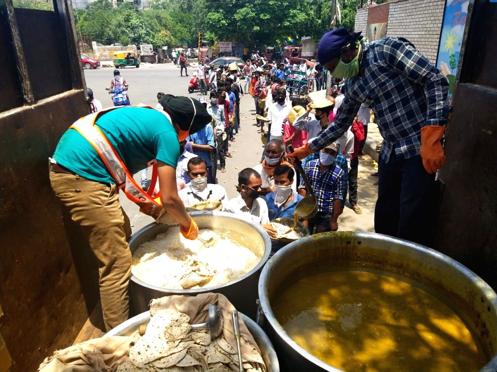 New Delhi, June 1 (IANS) Carrying forward the tradition of serving food through community kitchens beyond the walls of gurdwaras, Delhi Sikh Gurdwara Management Committee on Monday started 'Langar on Wheels' to provide food and water to the destitute