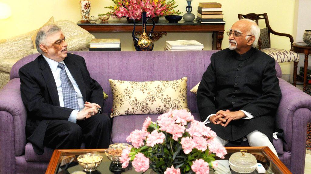 Kerala Governor Justice (Retd.) P. Sathasivam calls on the Vice President Mohd. Hamid Ansari, in New Delhi on Dec 12, 2014.